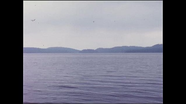 1940s: Rocks.  Lake.  Mountains.  Island.