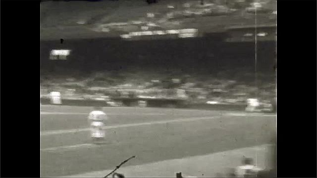1930s: UNITED STATES: view of baseball match from stands.