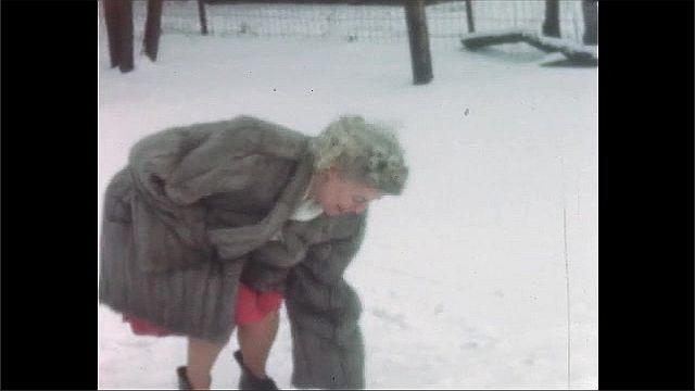 1940s: Pan of woman walking in yard, woman talks into camera.