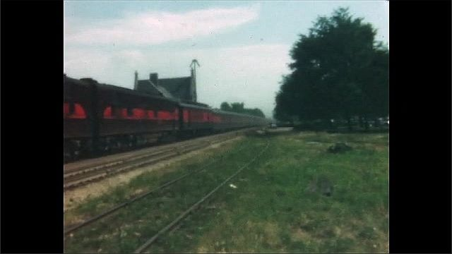 1940s: View of train pulling away from station, train stopping.