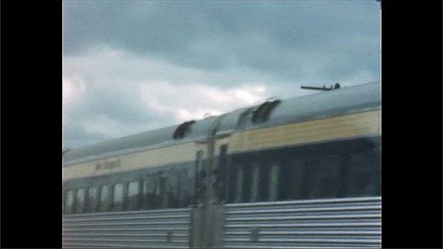 1940s: Close up, train drives past camera.
