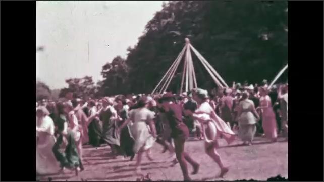 1940s: People in costume kneel. People in costume dance and skip.