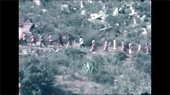 1940s: Musicians perform on veranda. People walk up trail on hillside.
