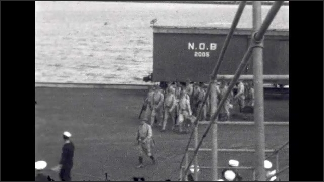 1920s: UNITED STATES: soldiers in uniform board ship. Captain welcomes soldiers on board. Soldiers march along dock. Train on docks.