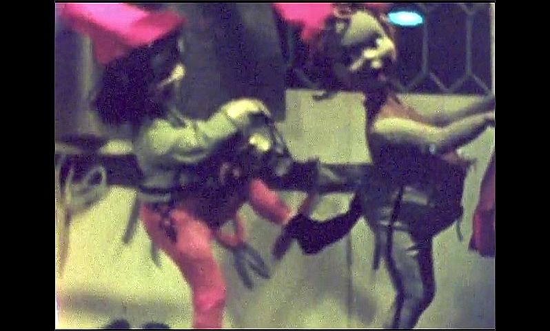 1940s: Animatronic doll pulls stings on other doll's pants.
