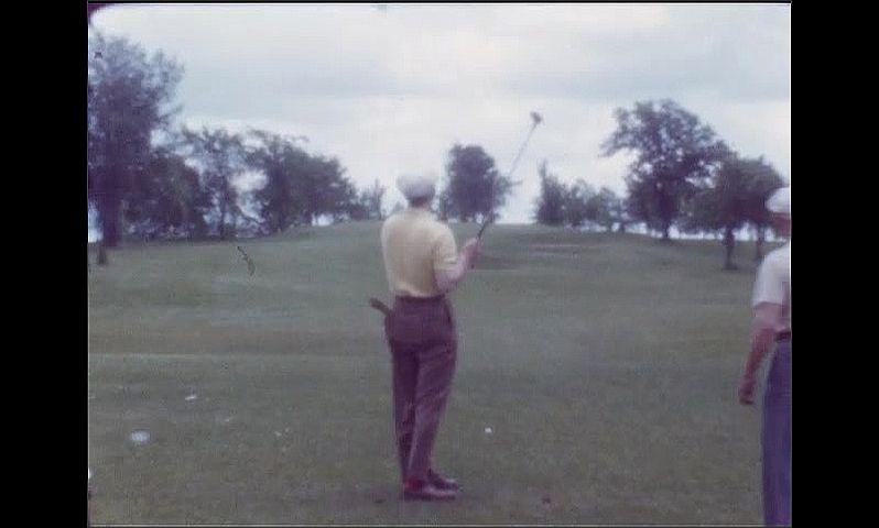 1940s: Men play golf.