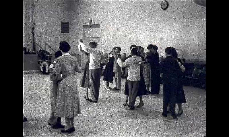 1950s: UNITED STATES: partners dance on ballroom dance floor. Graduation party.