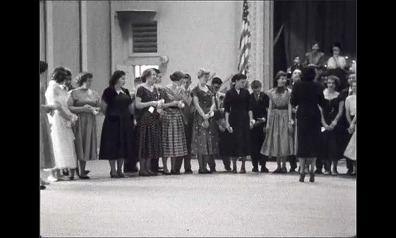 1950s: UNITED STATES: young people at graduation in 1953. Graduation ball.