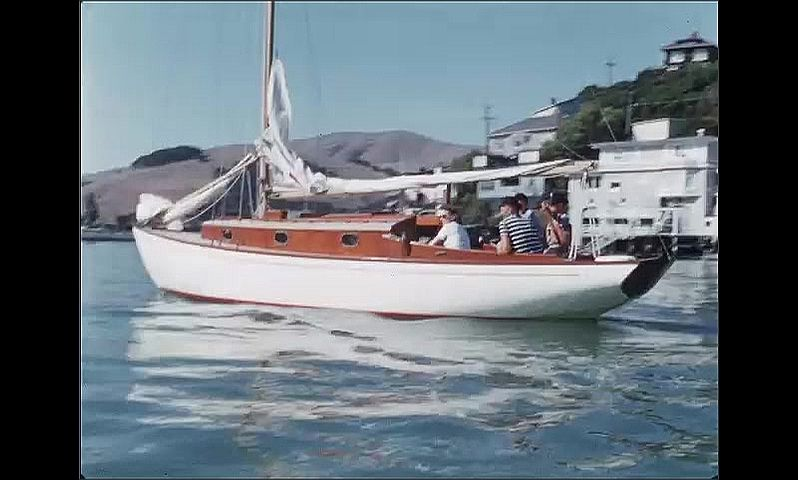 1950s: UNITED STATES: family on boat in bay.
