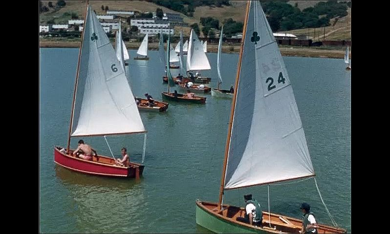 1950s: UNITED STATES: sailing boats in bay in summer. Sails on boats.