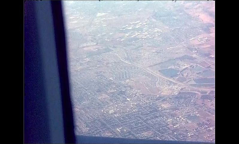 1960s: UNITED STATES: view of edge f mountains and start of city settlement. View of coast from above.