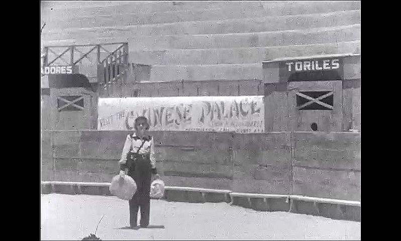 1940s: UNITED STATES: Olivas advert. Chinese Palace advert. Couple visit bull ring. Hotel Paso De Norte in street.