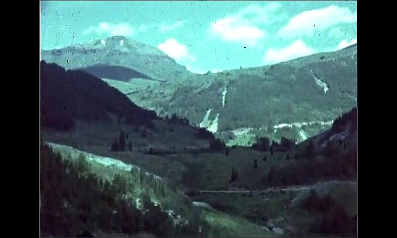 1940s: UNITED STATES: river in mountains. View across meadow. Snow on mountain top.