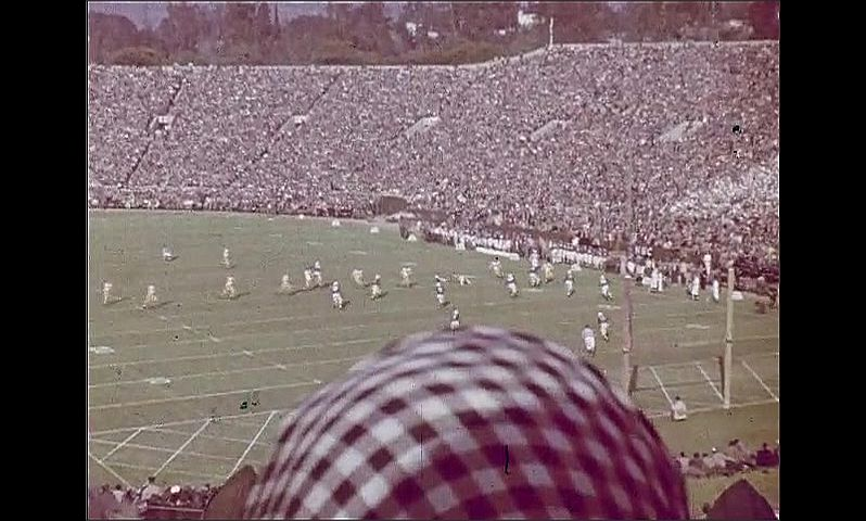 1950s: Stadium.  Football game.