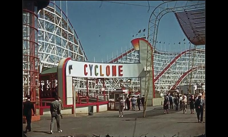 1930s: UNITED STATES: Cyclone ride at funfair. Giant 3D Monsters Alive show.