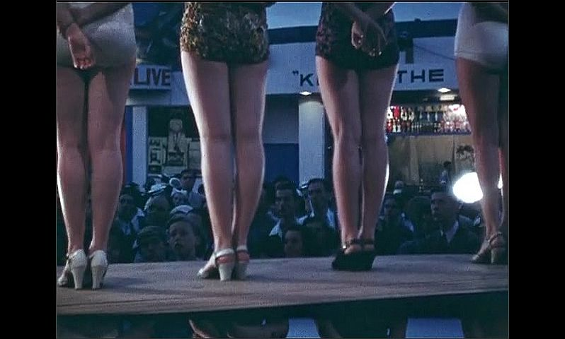 1930s: UNITED STATES: rear view of ladies on stage in swimwear. Natural History Museum attraction