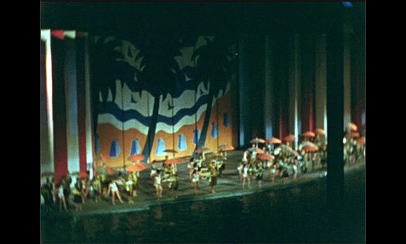 1930s: UNITED STATES: Aquacade show at night. Dancers on stage in evening. New York World Fair evening performance on stage.
