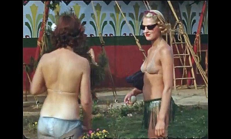 1930s: UNITED STATES: lady in bikini. Dog kennel. Lady in sunglasses.