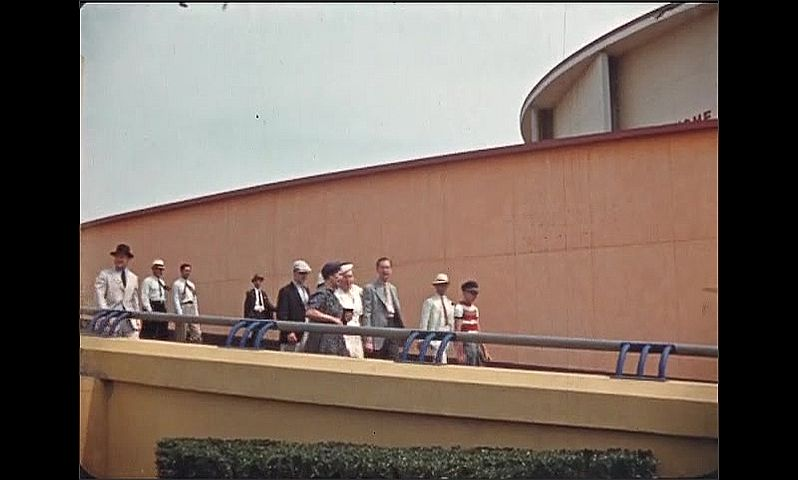 1930s: UNITED STATES: people walk down slope at World Fair in New York 1939. Buildings at World Fair.