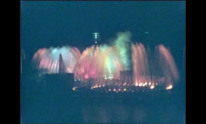 1930s: UNITED STATES: water fountains dance with light at night.