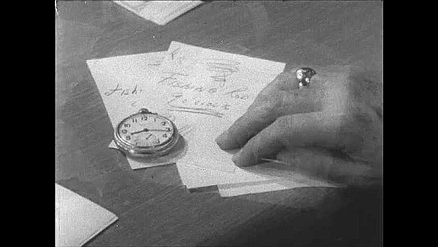 1950s: UNITED STATES: pocket watch on table. Hand taps fingers on desk. Man sits in church meeting. Passing of time. Fishing rod note.