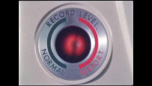 1960s: UNITED STATES: record level on machine. Distort control. Lady speaks into microphone