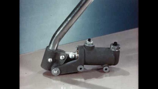 1940s: UNITED STATES: pump on table. Animation of pump and fluid in chamber.