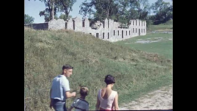 1950s: UNITED STATES: family enjoy walk in sunshine. Visit to stone ruins.