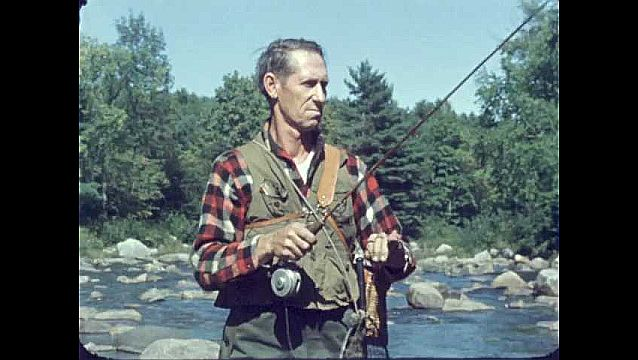 1950s: Mountain stream.  Man fishes.