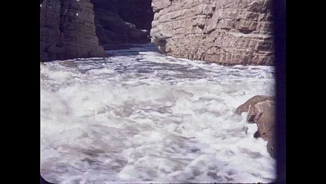1950s: UNITED STATES: river runs through canyon. Rock face in gorge