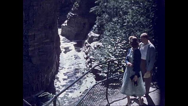 1950s: UNITED STATES: couple look down at river from platform.
