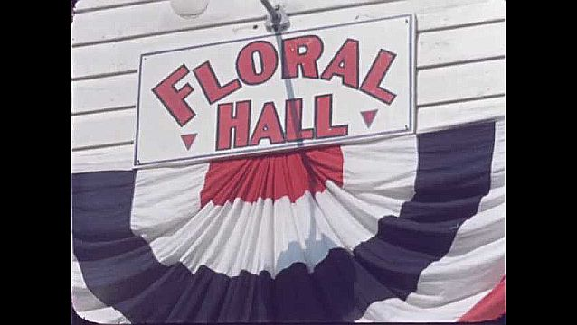 1950s: UNITED STATES: floral hall banner.