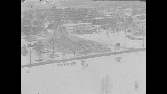1960s: Aerial views of destroyed building. Aerial view of downtown area.