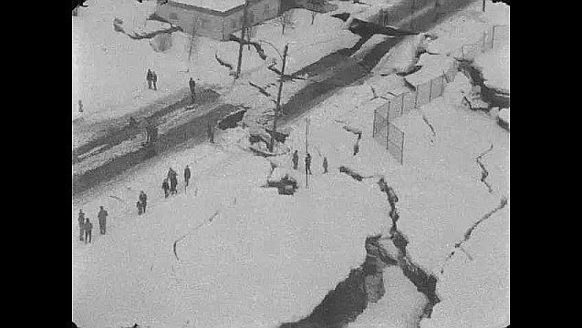 1960s: Aerial views of damaged buildings. Aerial view of landslide, damaged buildings.