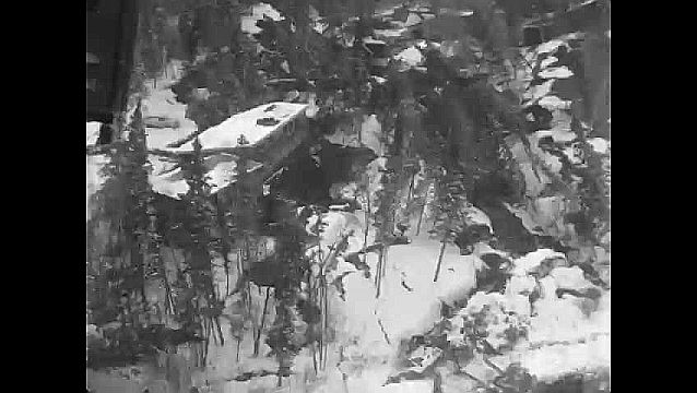 1960s: Aerial view of collapsed hillside, damaged houses.