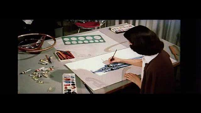 1960s: UNITED STATES: lady paints at artist's desk. People bring concept to life