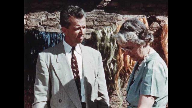 1950s: Missionaries oversee work of Indian woman.  Woman weaves rug.  Woman combs sisal fibers.