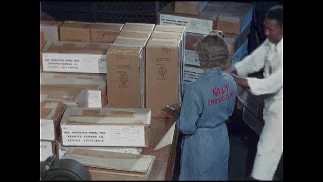 1950s: UNITED STATES: sailor signals on radio. Sailors run on deck of ship. Ship at sea