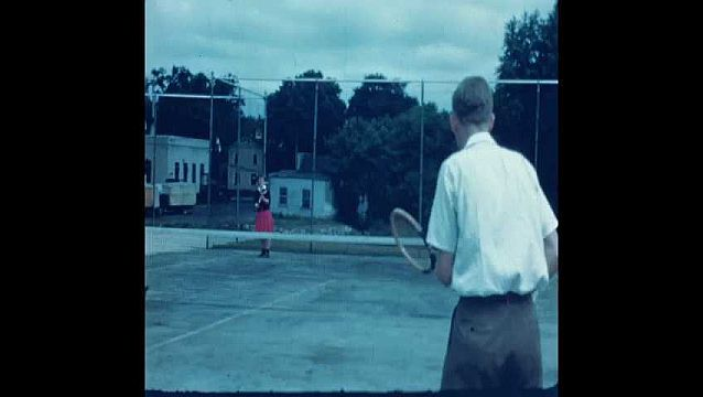 1940s: Woman and man play tennis.
