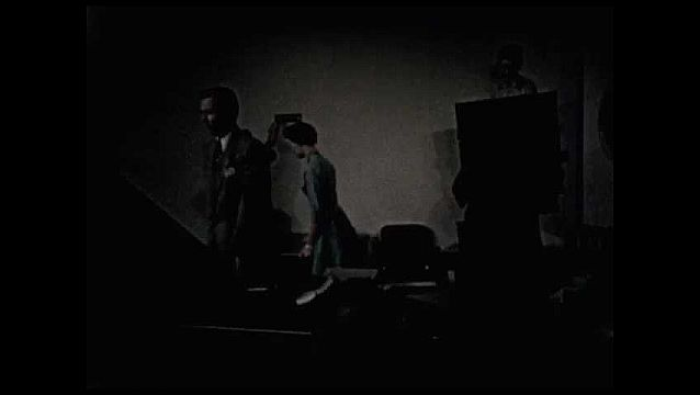 1950s: UNITED STATES: employees in office. Staff rearrange furniture. Lady moves heavy object