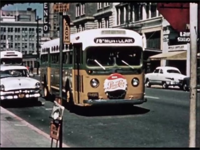 1950s: UNITED STATES: bus in street. Pepsi Cola advert on bus