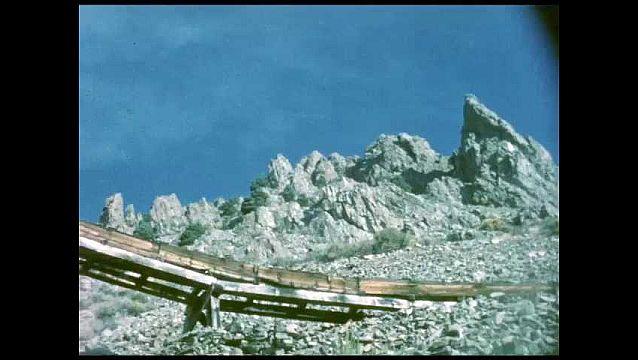 1940s: Mountains.  Elevated railroad bridge.
