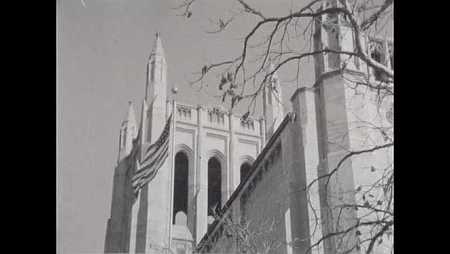 1950s: American flag flying in front of Tribune Tower.