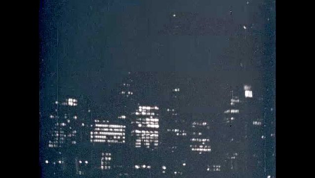 1950s: Chicago skyline at night.