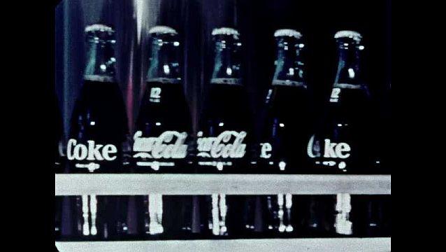 1960s: UNITED STATES: bottles on conveyor plant.