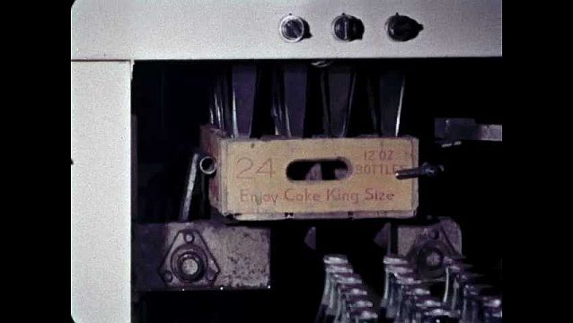 1960s: UNITED STATES: machine packs bottles of cola in cases. Cases of cola on fork lift truck
