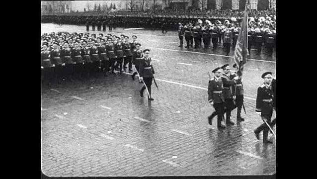 1950s: High angle, Soviet soldiers marching. Panning shots of soldiers. High angle of soldiers marching.