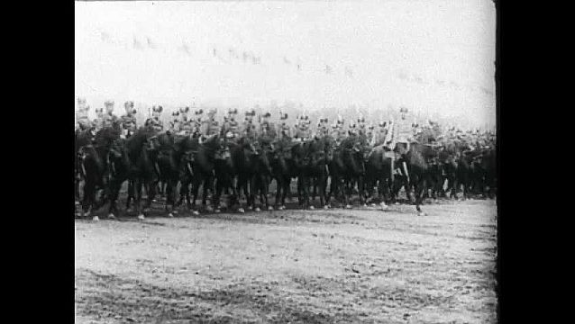 1950s: Russian soldiers on horseback. Soldiers ride from camera. Soldiers marching. Tzar Nicholas II walking past soldiers.