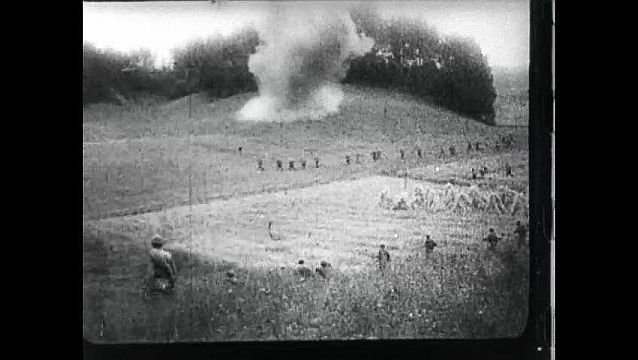 1950s: Soldiers running on field. Soldiers run past fires. Captive soldiers walk through trench.