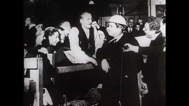 1940s: UNITED STATES: Wendell Willkie talks to people in air raid shelter. Willke talks to microphone.